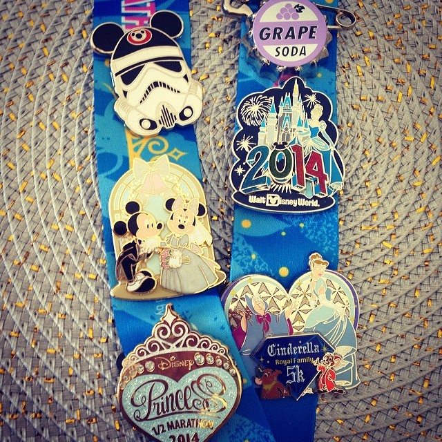 my pin collection -- cameron is a huge fan of pin trading and got me, skylar and peyton in it!  really love the few pins i got -- especially my race ones!  and the wedding mickey and  minnie ♥♥♥