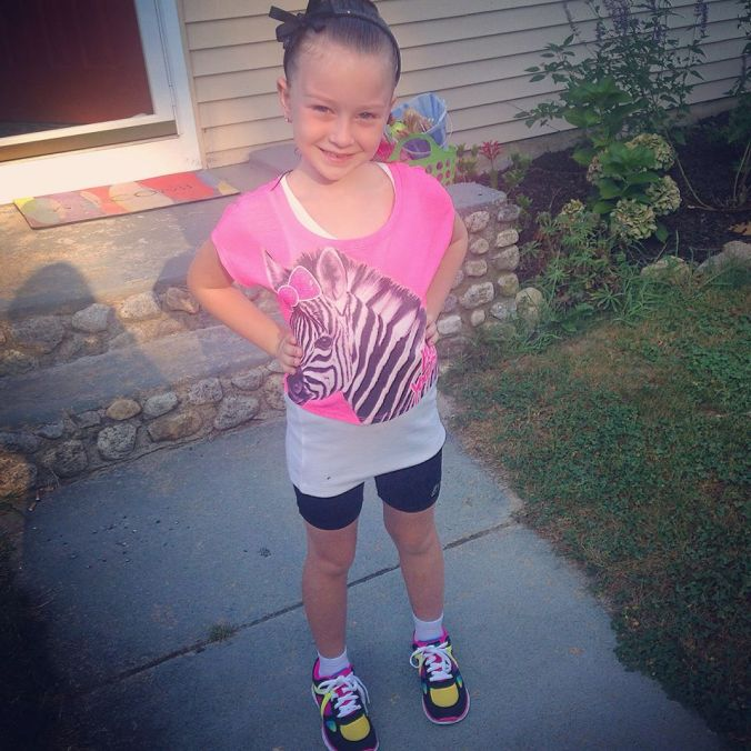 all ready for her first day of first grade! she picked out this outfit from the shoes to her headband!